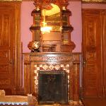 Beautiful wood work everywhere, and amazing original fireplace
