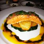 Salmon over potatoes & spinach w/ passion fruit sauce