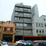 The hotel is on South Bridge Road, directly opposite the junction with Hong Kong St.