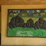 the hand-crafted carved relief showing the five volcanoes & names of gorilla families