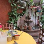 One of the three courtyard tables at Tacos Don Felix