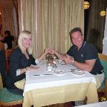 ENJOYING DINNER IN RESTAURANT OF HOTEL HELVETIA INTERGOLF, CRANS-MONTANA.