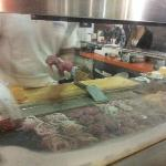 Cooking fresh ground meat right in front of you. The smell is amazing!