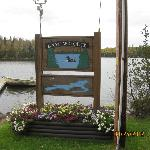 Lodge sign next to the lake and their dock