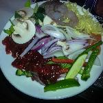 Collect raw ingrediants, beef, chicken, prawns in a plate