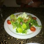 Salad with apple slices, walnuts and gorganzola cheese