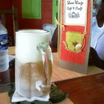 a very cold local beer - Carib - on a hot sunny day at Shore Things cafe
