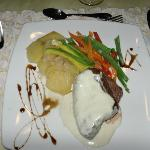 One of the delicious meals at the Palace, filet, blue cheese sauce and vegetables
