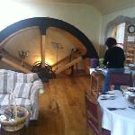 The original wheel dominating the dining room