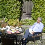 Hubby enjoying breakfast in the garden