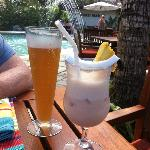 Cold beer and delicious mocktail siting by the pool having lunch