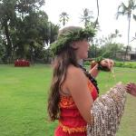The Greeter with the shell leis