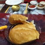 French bread served with butter and their home made jam
