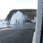 Waves washing the famous phone box