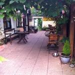 The covered vineyard alfresco area outside the main establishment