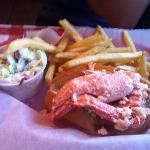 Lobster roll with plain tasting fries and Cole Shaw