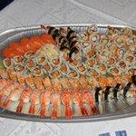 A combo of tiger rolls, shrimp sushi, salmon sushi, etc.