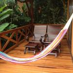 Deck with hammock, chairs and tub on other side