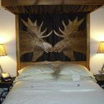 The headboard of the bed in the Moose Room