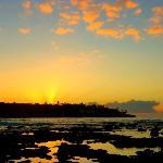 sunrise over Poipu reflecting in the tidepools