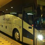 """Picture of the GCTours Bus with the sign """"Let's Go!"""""""