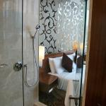 Premier rooms have a glass wall for bathrooms