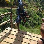 Rafael doing a one-handed handstand into the zipline!