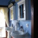 His & hers sinks, plus door to private balcony