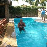 arnaldo is playing in the pool