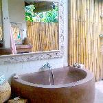 Bath tub in open bathroom