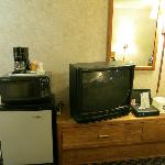 Room with tv, fridge, microwave oven