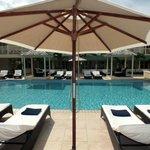 Swimming pool with sun loungers and umbrellas