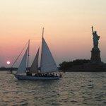 The Shearwater sailing towards Liberty at twilight.