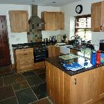Kitchen with ceramic hob, electric fan oven, dishwasher, microwave, washer dryer & fridge freeze