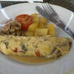 Breakfast, Omelet with potatoes, mushrooms and tomato