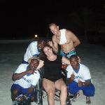 The captains water team carrying me in my wheelchair