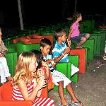 The kids watching a movie at the kids club