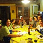 Group dinner in Lella's kitchen after a cooking lesson.