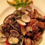 Black spaghetti with zucchini blossoms and clams