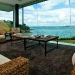 View from one of the living rooms out over the pool and Hauraki Gulf