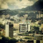 View of hotel with the rest of Poblado, blurred--nearby Charlee hotel is tower to left.