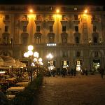 The hotel at night. One of the several bars in the square can be seen on the left.