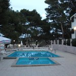 Swimming pool area and sun beds