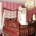 Bedroom of Victorian Suite with chandelier