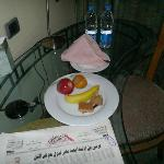 the welcome fruit platter, water, and newspaper