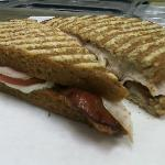 Hot Brown Panini~Smoked Turkey, Crisp Bacon, Sax Signature parmesan Cheese Spread, Sliced Tomato