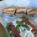 Delicious caprese salad and perfect pastrami and cheese sandwich.