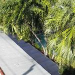 Looking down at the pool from the sunbathing deck