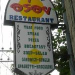 Road sign above the restaurant