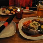 Elk burger and bison & duck sausages in a dim and cozy atmosphere